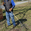 TIM JEAN/Staff photo<br />   <br /> Art Veasey, past president of Haverhill Rotary rakes up debris in the island along Lincoln Avenue during a Earth Day cleanup in Haverhill.     4/21/18