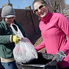 TIM JEAN/Staff photo<br />   <br /> Carly Andrews, left, of Salem, NH., and Chablis Cormier, of Lawrence, who both work in Haverhill pick up trash along Lincoln Avenue next to Riverside Park, during a Earth Day cleanup in Haverhill.     4/21/18