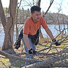 TIM JEAN/Staff photo<br />   <br /> Isaiah Williams, of Haverhill, a member of Haverhill High School VIP club stacks up tree branches and other debris at the Merrimack River Park on Route 110 during an Earth Day cleanup in Haverhill.   4/21/18