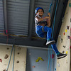 AMANDA SABGA/Staff photo <br /> <br /> Rhaesha Nkoba, 10, climbs the rock wall at the Haverhill YMCA.<br /> <br /> 8/15/18