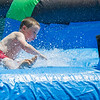 AMANDA SABGA/Staff photo<br /> <br /> Nichola Avallone, 8, slides to a stop on an inflatable water slide kids cool down during the Haverhill Recreation Department's summer camp annual field day at Riverside Park.  <br /> <br /> <br /> 8/7/18