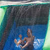AMANDA SABGA/Staff photo<br /> <br /> Shawn Dowling, 11, jumps down an inflatable slide as kids cool down during the Haverhill Recreation Department's summer camp annual field day at Riverside Park. <br /> <br /> 8/7/18