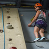 AMANDA SABGA/Staff photo <br /> <br /> Maeve Boucher, 10, climbs the rock wall at the Haverhill YMCA.<br /> <br /> 8/15/18