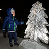 CARL RUSSO/Staff photo. Alexander Hayes, 3 takes a close look at the ice sculpture shaped as a Christmas tree. The Greater Haverhill Chamber of Commerce held its 26th. annual Christmas Stroll Friday night. Plenty of activities for the family including Pentucket Bank's Santa's Village at Harbor Place. Santa greeted over a hundred  children in his village before heading over to Washington Square to light the Christmas tree. 12/07/2018