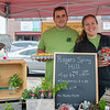 AMANDA SABGA/Staff photo<br /> <br /> Nick Bradshaw and Hillary Rogers pose for a photo at the Rogers Spring Hill Farm booth during opening day of the Haverhill Farmer's Market in downtown Haverhill. <br /> <br /> 6/23/18