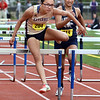 CARL RUSSO/Staff photo Haverhill's Jayla Kitchings wins her race in the 100 meter hurdles beating Lawrence high senior, Rosalinda Rosario, right.  East Mass. Div. 1 boys and girls  track meet was held at Andover High school Monday afternoon.  5/28/2018