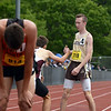 CARL RUSSO/Staff photo Haverhill's Keith May, helping one of his opponents up after a fall,  captured 4th. place in the 800 meter race. East Mass. Div. 1 boys and girls  track meet was held at Andover High school Monday afternoon on May 28.  5/28/2018