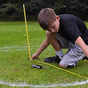 TIM JEAN/Staff photo<br /> <br /> Casey Peugh, 11, of Haverhill measures how close a ball is to the hole during the first day of the Haverhill Gazette's 48th annual Hole-In-One Contest. The contest was held at Murphy's Garrison Golf Center on Hilldale Avenue in Haverhill .  10/3/18