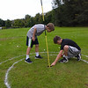 TIM JEAN/Staff photo<br /> <br /> Tommy Murphy, 10, left, and Casey Peugh, 11, both of Haverhill measures how close a ball is to the hole during the first day of the Haverhill Gazette's 48th annual Hole-In-One Contest. The contest was held at Murphy's Garrison Golf Center on Hilldale Avenue in Haverhill .  10/3/18