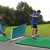 TIM JEAN/Staff photo<br /> <br /> Thomas Goodwin, left, and Nick Samaha, both 13, of Haverhill, swing away during the first day of the Haverhill Gazette's 48th annual Hole-In-One Contest. The contest was held at Murphy's Garrison Golf Center on Hilldale Avenue in Haverhill .  10/3/18