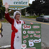 TIM JEAN/Staff photo<br /> <br /> Dianne Connolly, Principal at Pentucket Lake Elementary School waves to cars while dressed as Mrs Claus during the first day of the Haverhill Gazette's 48th annual Hole-In-One Contest. The contest was held at Murphy's Garrison Golf Center on Hilldale Avenue in Haverhill .  10/3/18