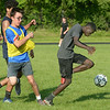 CARL RUSSO/staff photo. Havehill high soccer players, Jonas Kwiatkowski, left and Malik Giwa both juniors fight for the ball during a practice scrimmage. The Haverhill high boys soccer team held practice Friday afternoon. 8/24/2018