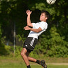 CARL RUSSO/staff photo. Haverhill senior captain, Ian Miller heads the ball during a practice scrimmage. The Haverhill high boys soccer team held practice Friday afternoon. 8/24/2018
