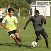 CARL RUSSO/staff photo. Havehill high soccer players, Louis Dimopoulos, left and Malik Giwa both juniors fight for the ball during a practice scrimmage. The Haverhill high boys soccer team held practice Friday afternoon. 8/24/2018