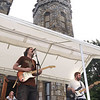 CARL RUSSO/staff photo. GAZETTE: The Newburyport band, Eagle In The Attic perform with the castle towering behind them. They are Randy Robinson, left on Guitar, Bill Sullivan on Bass and Chris Hall on drums. The Steve Lyons Fund hosted the annual Rock Out! Cookout on Saturday, August 25, at Winnekenni Castle in Haverhill. <br /> <br /> This family-friendly afternoon of music, food and fun benefited the Haverhill High School Marching Band Uniform Fund.<br /> <br /> The music included performers from Be Imagine Music Studio and DeAngelis School of Rock as well as a host of local performers. <br /> <br /> The mission of the Steve Lyons Fund, Inc. is to support the arts for youth in Haverhill through events and fund-raising.  8/25/2018