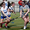 BRYAN EATON/Staff Photo. Georgetown's Brooke O'Donnell, left, and Haverhill's Emma Laviolette go for the loose ball in Tuesday afternoon lacrosse action. 4/2/2019