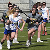 BRYAN EATON/Staff Photo. Lindsey Feeks moves past Haverhill's Jessica Wardle, right in Tuesday afternoon lacrosse action. 4/2/2019