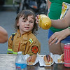 MIKE SPRINGER/Staff photo<br /> Four-year-old Cole Balkus watches as his mother prepares to put mustard on his hot dog during the National Night Out event Tuesday at Swasey Field in Haverhill.<br /> 8/6/2019