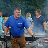 MIKE SPRINGER/Staff photo<br /> Haverhill police officer Scott Ziminski grills hamburgers for guests Tuesday during the National Night Out at Swasey Field in Haverhill.<br /> 8/6/2019