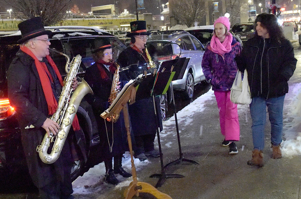 TIM JEAN/Staff photo <br /> <br /> Members of the Sax Pack from left, Ron Hoehn, Laurie Paszko, and Gregory Lyons perform along Merrimack Street during the Haverhill Chamber of Commerce annual Christmas Stroll in Haverhill.   12/6/19