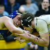 CARL RUSSO/Staff photo. GAZETTE: Haverhill's Ryan McCartney, right, defeated Methuen's Erick Lucas 4-3 in over time in the 195 pound match. Haverhill defeated Methuen 36-30 in Wednesday night wrestling. 1/16/2019