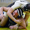 CARL RUSSO/Staff photo. GAZETTE: Haverhill's Ryan McCartney, top, defeated Methuen's Erick Lucas 4-3 in over time in the 195 pound match. Haverhill defeated Methuen 36-30 in Wednesday night wrestling. 1/16/2019