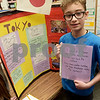 TIM JEAN/Staff photo<br /> <br /> Deklyn Palma, a fifth grader at the Consentino School shows off his project during 10th Annual Math Museum display in the library at Haverhill High School.    6/6/19