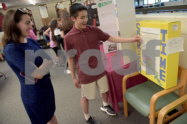 TIM JEAN/Staff photo<br /> <br /> Eighth grader Russell Leung, right, explains his project to his Nettle School teacher Molly Cartier during 10th Annual Math Museum display in the library at Haverhill High School.    6/6/19