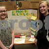 TIM JEAN/Staff photo<br /> <br /> Mikayla DeFrank, left, and Ana Neira, both seventh graders at the Consentino School show off their Japanese Multiplication project during 10th Annual Math Museum display in the library at Haverhill High School.    6/6/19