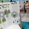 TIM JEAN/Staff photo<br /> <br /> Laura Paris, a seventh grader at the Whittier School holds her 1st place award for her How Many Leaves on a Tree  project during 10th Annual Math Museum display in the library at Haverhill High School.    6/6/19