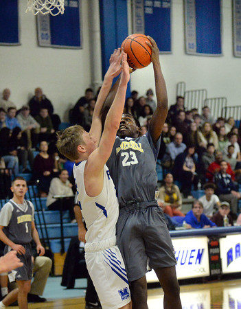 CARL RUSSO/Staff photo. Haverhill's Jeremyah Phillips drives to the hoop against Methuen's Tyler Carrien. Haverhill defeated Methuen 57-47 in boys basketball action early in the season. 1/4/2019