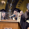 CARL RUSSO/Staff photo Haverhill graduate, Tyler Roman uses the microphone to get his message across after receiving his diploma to the surprise of class president Meg Sheehan during Haverhill high's commencement ceremony Friday evening at Trinity Stadium. Diplomas were presented to 392 graduates.  5/31/2019
