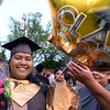 CARL RUSSO/Staff photo Yasmine Ledesma is showered with gifts after the Haverhill high commencement ceremony Friday evening at Trinity Stadium. Diplomas were presented to 392 graduates. 5/31/2019
