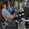 MIKE SPRINGER/Staff photo<br /> Arthur Veasey, left, and Haverhill City Councellor Tim Jordan visit while working out Monday at the newly rebuilt and reopened Cedardale Health and Fitness Club in Haverhill.<br /> 6/17/2019