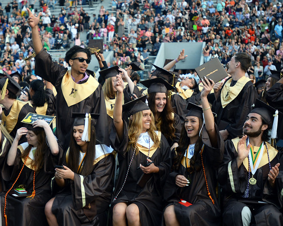 CARL RUSSO/Staff photo Haverhill graduates celebrate after Haverhill high's commencement ceremony Friday evening at Trinity Stadium. Diplomas were presented to 392 graduates. 5/31/2019