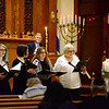 CARL RUSSO/Staff photo Vera Broekhuysen, Temple Emanu-El's Cantor, far right, leads a group of singers during the service. <br /> <br /> Temple Emanu-El in Haverhill held a Yom Hasho' Ah Holocaust Remembrance Day service to remember and honor the millions of Holocaust victims. Frank Qunitiliani, a tailor who now lives and works in Haverhill, talked about his experiences living under the Nazi regime. 5/3/2019