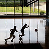 MIKE SPRINGER/Staff photo<br /> Two boys play basketball Monday at the newly redesigned and rebuilt Cedardale Health and Fitness Club in Haverhill, which had been destroyed by fire in 2017. <br /> 6/17/2019