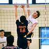 CARL RUSSO/Staff photo. Haverhill's Kleiner Fritz spikes the ball. Haverhill defeated North Andover 3-0 in boys volleyball action. 4/26/2019