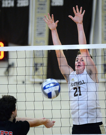 CARL RUSSO/Staff photo. Haverhill's Kevin Connor defends his net. Haverhill defeated North Andover 3-0 in boys volleyball action. 4/26/2019