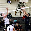 CARL RUSSO/Staff photo. Haverhill's Nick DiMattia, left, keeps the ball in play with North Andover's David Soskov. Haverhill defeated North Andover 3-0 in boys volleyball action. 4/26/2019