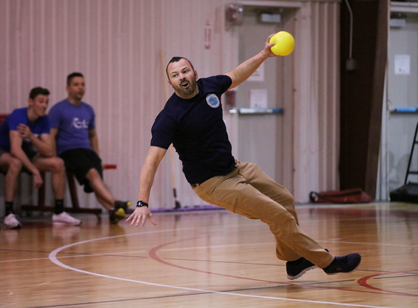 MIKE SPRINGER/Staff photo<br /> Chris Saggese of Hampstead takes a fall while competing in the Chamber Business After Hours third-annual dodgeball tournament Wednesday at the Plaistow Community YMCA. The event collects food and gifts for the YMCA's Giving Trees, which are located in the lobbies of the Plaistow and Haverhill YMCAs. The collected items will be distributed to families in need.<br /> 11/20/2019