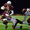 CARL RUSSO/Staff photo. Whittier's Jeremias Collazo struggles to run with the ball.  Whittier Tech was defeated 36-22 by Ipswich in Friday, November 8 football action. 11/8/2019