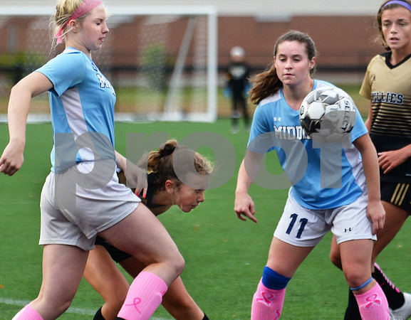 CARL RUSSO/Staff photo Haverhill's Marisa Allen goes low in between Dracut defenders to head the ball. Haverhill defeated Dracut 2-1 in girls soccer action Tuesday afternoon. 10/8/2019