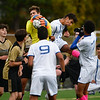 CARL RUSSO/Staff photo Haverhill's goalkeeper, Matt Corliss leaps into the air to make the save beating Methuen's Ayoub Dakiri to the ball. Haverhill defeated Methuen 4-0 in boys soccer action Tuesday afternoon. 10/22/2019