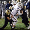 CARL RUSSO/Staff photo. Haverhill's Sam Colon-Waldron tackles Lexington quarterback Mason Hatfield. Haverhill defeated Lexington 42-28 in Friday night football action. 11/15/20199