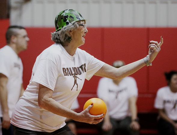MIKE SPRINGER/Staff photo<br /> Dianne Connolly, Director of Multi-Tiered Systems of Support for Haverhill Public Schools and president of the Haverhill YMCA Board of Directors, taunts an opponent while playing in the Chamber Business After Hours third-annual dodgeball tournament Wednesday at the Plaistow Community YMCA. The event collects food and gifts for the YMCA's Giving Trees, which are located in the lobbies of the Plaistow and Haverhill YMCAs. The collected items will be distributed to families in need.<br /> 11/20/2019