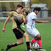 CARL RUSSO/Staff photo Haverhill's Connor Buscema fights for the ball with Methuen player. Haverhill defeated Methuen 4-0 in boys soccer action Tuesday afternoon. 10/22/2019