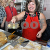 CARL RUSSO/Staff photo. Dina Aspogiannis of Newburyport serves a large piece of Bougatsa, a cream custard dessert. The Annual Greek Festival sponsored by the Holy Apostles Saints Peter and Paul Greek Orthodox church in Haverhill was held November 1, 2. <br /> <br /> The event, held at the Hellenic Community Center, will continue on Sunday, November 3 with plenty of  authentic Greek cuisine such as lamb shanks, souvlaki, moussaka, pastichio, spinach pie, and other specialties.11/01/2019