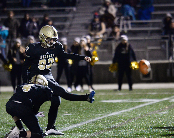 CARL RUSSO/Staff photo. Haverhill exchange student, Jakob Wimmer of Germany kicks the extra point with Dryden Fisher holding. Haverhill defeated Lexington 42-28 in Friday night football action. 11/15/2019