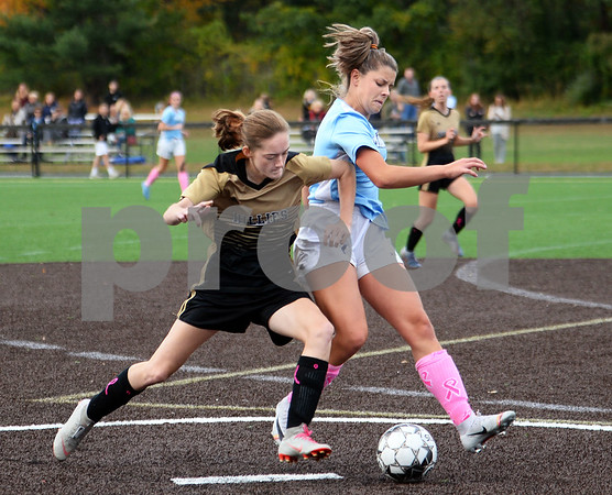 CARL RUSSO/Staff photo Haverhill's Emma Eramo battles for the ball with Dracut defender. Haverhill defeated Dracut 2-1 in girls soccer action Tuesday afternoon. 10/8/2019